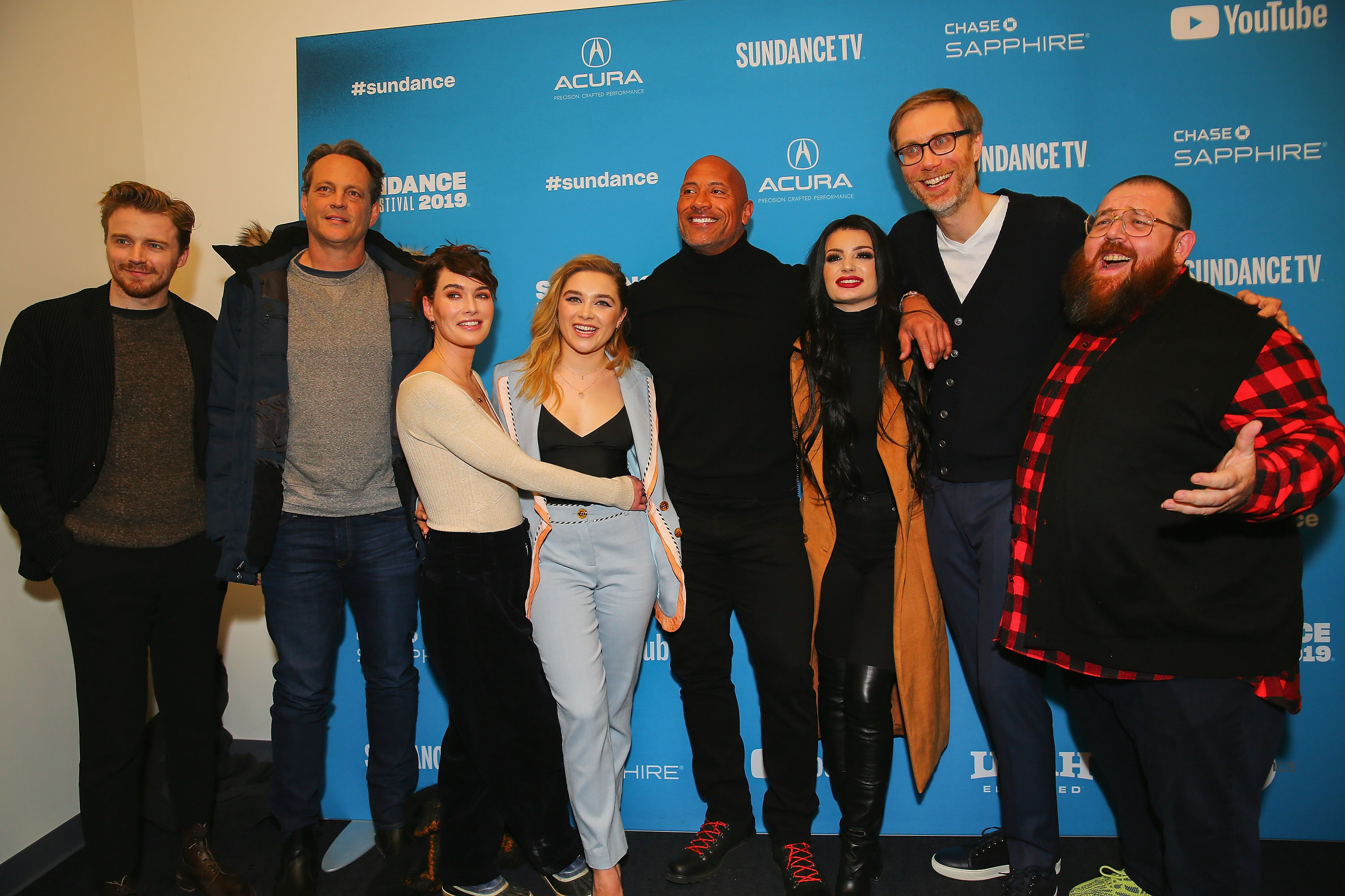 "Actors Jack Lowden, Vince Vaughn, Lena Headey, Florence Pugh, Dwayne Johnson, Paige, executive producer Stephen Merchant, and actor Nick Frost pose for a photo at the screening of ""Fighting with My Family"" at the Sundance Film Festival in Park City, Utah."