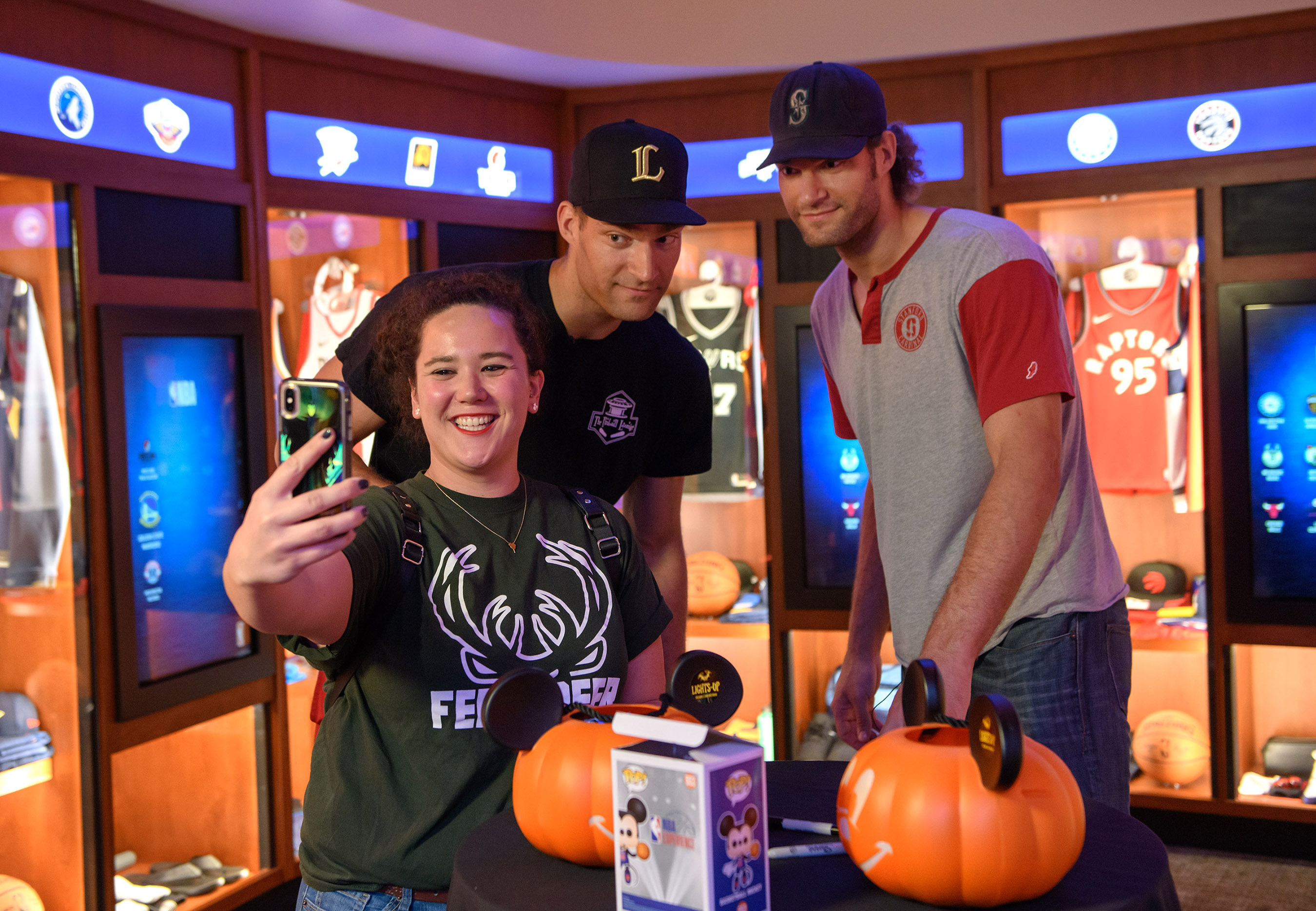 NBA players Brook (center) and Robin (right) Lopez take a break from their schedule to celebrate Halloween with guests at NBA Experience, Oct. 31, 2019, at Disney Springs at Walt Disney World Resort in Lake Buena Vista, Fla. The twin brothers spent time with fans and participated in some of the 13 interactive and hands-on activities inside the first-of-its-kind destination. (Todd Anderson, photographer)